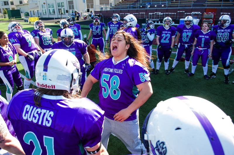by: COURTESY OF JOHN LARIVIERE - Injured Fighting Fillies lineman Ruby Aliimatafitafi leads her team in a pregame chant prior to kickoff against the Portland Shockwave.