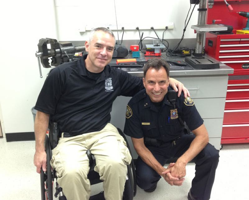 by: PORTLAND POLICE BUREAU - Portland Police Officer Paul Meyer and Chief Mike Reese.
