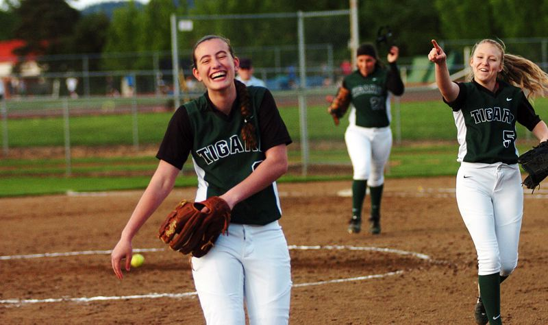by: DAN BROOD - FUN FINISH -- Tigard sophomore third baseman Hannah Spadafora (left), with freshman pitcher Kaitlyn Nunn pointing at her, seems overjoyed after catching a line drive for the final out of Monday's game. Spadafora just returned to action after suffering a major injury in the fall.
