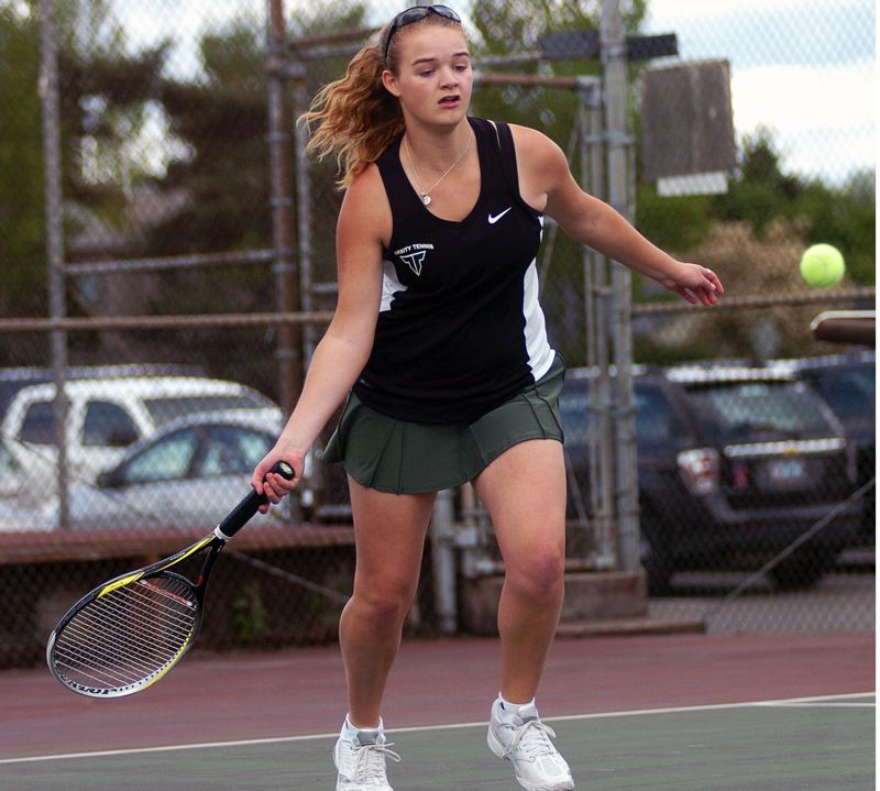 by: DAN BROOD - WINNING FORM -- Tigard senior Courtney Roshak gets ready to hit a shot during her No. 1 singles victory over Newberg's Sam Russo.
