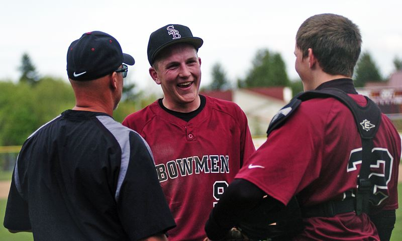 by: DAN BROOD - GOOD TIMES -- Sherwood coach Jon Strohmaier (left), junior pitcher Zak Taylor (center) and junior catcher Adley Rutschman share a laugh in between innings during the Bowmen's win over Liberty on Friday.