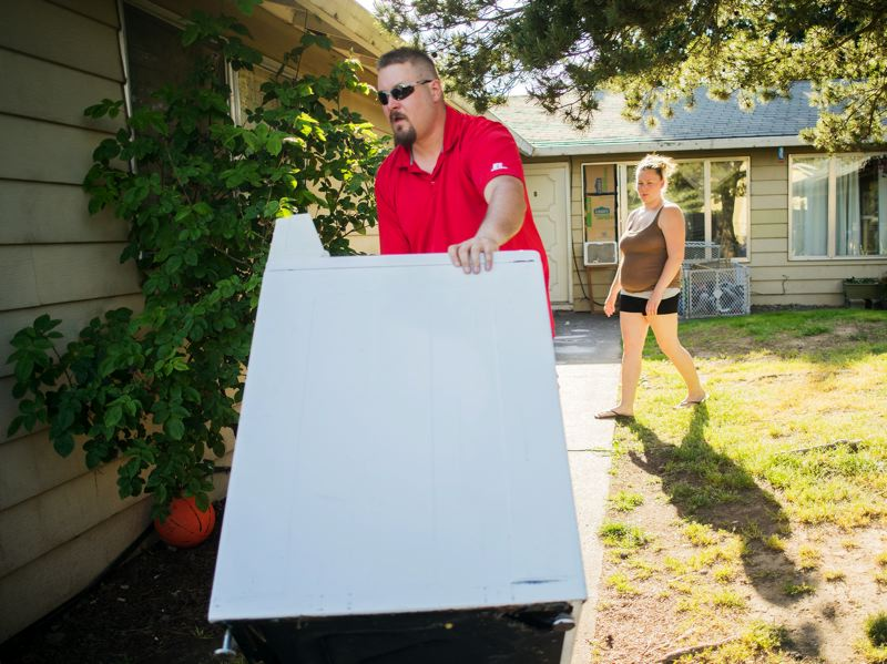by: HILLSBORO TRIBUNE PHOTO: CHASE ALLGOOD - Ron Streit, owner of Westside Metal Recycling, delivers a working washing machine to Aquilla Troutmans  Cornelius home.