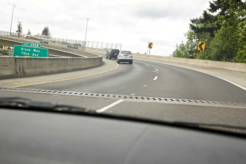 by: TIMES PHOTO: JAIME VALDEZ - ODOT officials say that a connecting joint along the Highway 217 and Interstate 5 flyover has cone out of alignment, which may have caused several crashes along the ramp in the past few weeks.