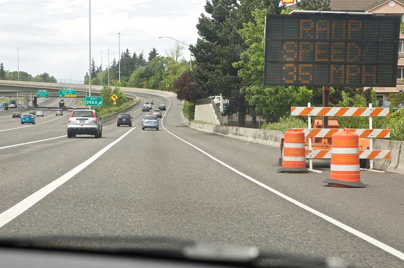 by: TIMES PHOTO: JAIME VALDEZ - An electronic speed sign warns drivers to slow down as they merge from northbound Interstate 5 onto Highway 217.