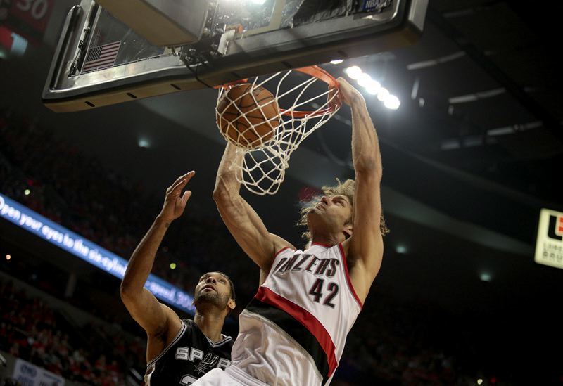 by: TRIBUNE PHOTO: JONATHAN HOUSE - Robin Lopez gets inside Tim Duncan for a dunk.