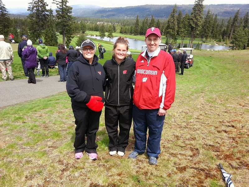 by: MITCH ZIEGLER / COURTESY - Aaren Ziegler (center), a member of the Wisconsin women's golf team, poses with former Canby High School coaches Terry Bailey (left) and Jason Mathews (right) during the NCAA West Regional tournament May 8-10 in Washington state.