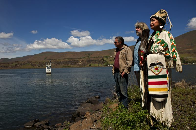 by: PAMPLIN MEDIA GROUP: JAIME VALDEZ - Sean Cruz, Treothe Bullock and Aurolyn Stwyer stand where Celilo Falls used to be before The Dalles Dam was completed in 1957.