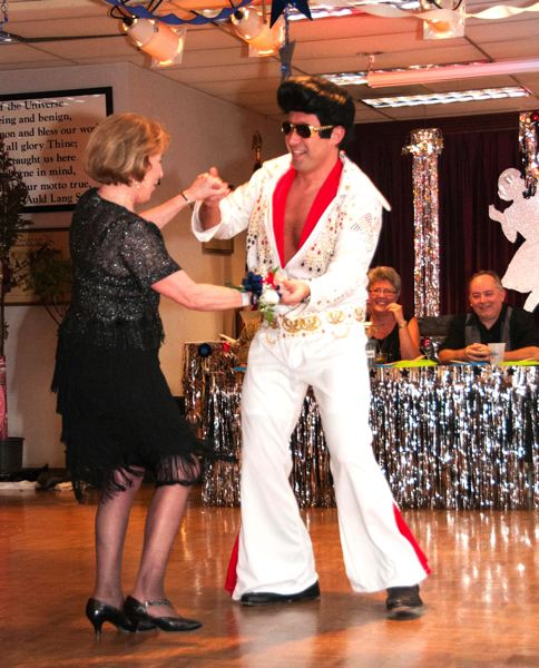 by: CONTRIBUTED PHOTO: CARL TEBBENS - Mayor Shane Bemis, aka Elvis, replete with spray tan, pompadour and gold-rimmed shades, shakes a leg with his partner Dory Durrell during the 2014 Dancing With the Elks competition.