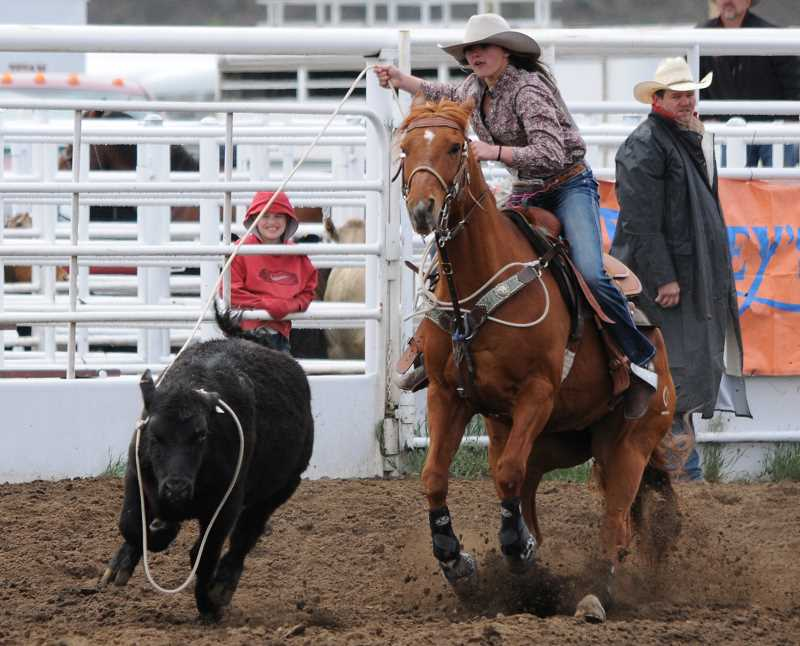by: LON AUSTIN/CENTRAL OREGONIAN - Bailey Beall wins the first go round of breakaway roping at the Tri-County Rodeo, which was held in Prineville on Saturday and Sunday. Beall had a time of 3.37 seconds on the run.
