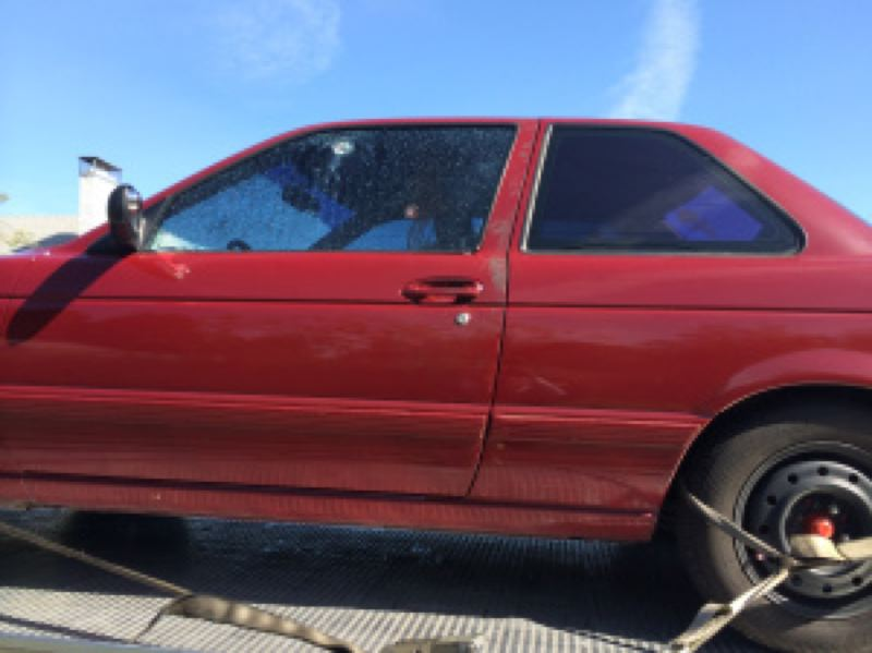 by: KOIN NEWS 6 - Two bullet holes can be seen in the window of the car towed from the shooting scene.
