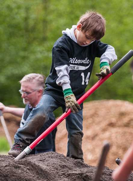 by: SPOKESMAN PHOTO: JOSH KULLA - Community volunteers of all ages took part in WERK Day Saturday at Wilsonville's Memorial Park.