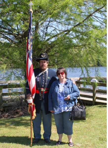 by: CONTRIBUTED PHOTO - Patricia Roberts poses for a photo with Ed Boots who was an ancestor of a soldier who was captured at the Battle of Plymouth and died at Andersonville Prison in Georgia.