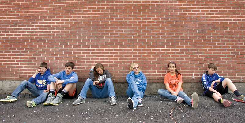 by: KEVIN SPERL - The cast and crew of 'The Red Notebook' sit along the wall that was featured in their award-winning short film. From left: Tyler Owens, Trevor Smith, Rebecca Reed, Katy Norris, Lilyanna Jensen and Addison Peer.
