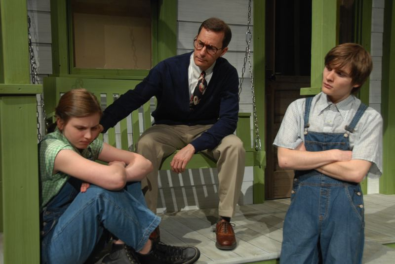 by: PHOTO BY: KARMIN TOMLINSON - Atticus Finch (Mark Schwahn) comforts Scout (Jenika Flynn), left, as Jem (Danny Nelson) looks on.