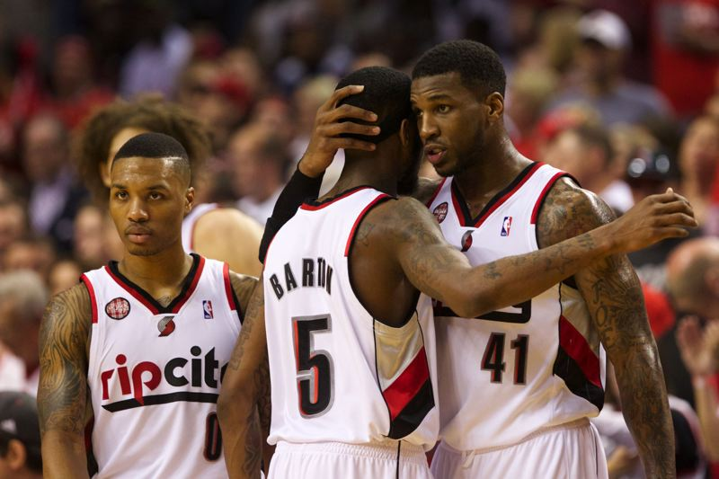 by: TRIBUNE PHOTO: JAIME VALDEZ - Trail Blazers forward Thomas Robinson (right) hugs guard Will Barton after a timeout in the second half of Game 4 at Moda Center.