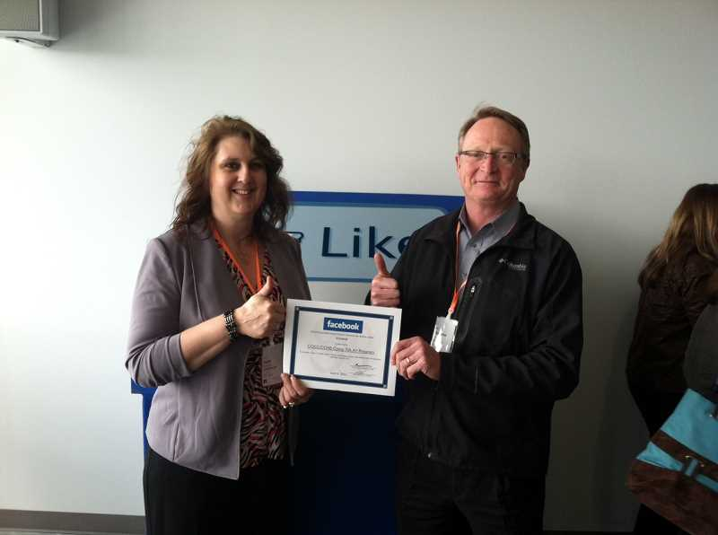 by: CENTRAL OREGONIAN - Suzie Kristensen, administrator of the COCC Prineville Campus, and Matt McCoy, COCC vice president of administration, accepted a grant from Facebook for computer certification courses April 4.