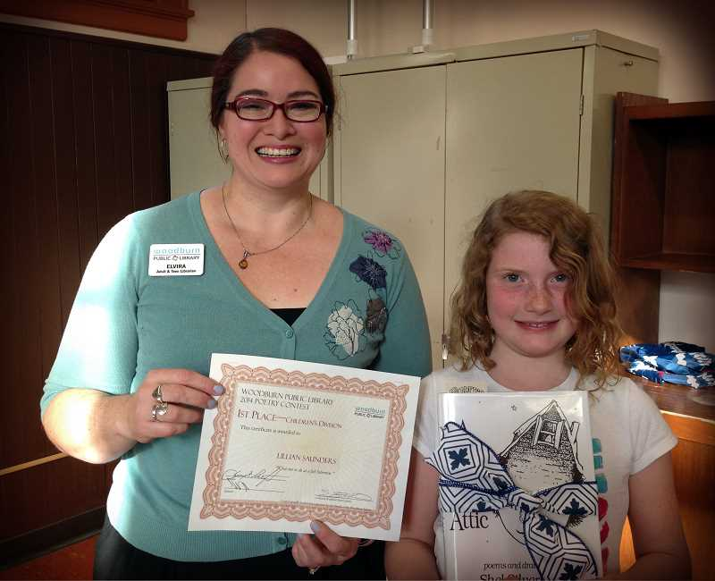 by: SUBMITTED - Lillian Saunders, right, children's division winner of the Woodburn Public Library poetry contest, poses with Adult and Teen Librarian Elvira Sanchez Kisser.