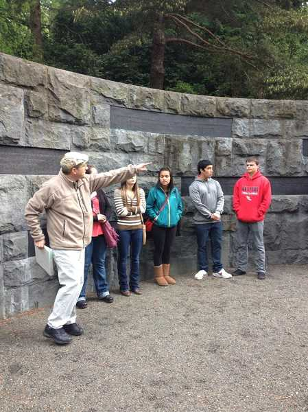by: JESSICA SCHMIDTMAN - David Rutiezer, a docent at the Holocaust Memorial in Portland's Washington Park, points out the quotations on the wall at the memorial to Kennedy High School students during their visit May 6. Students pictured are (left to right) Mackenzie Moreno, Stephanie Wurdinger,  Helen Canchola, Eduardo Ramirez and Joey Wright.