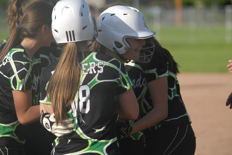 by: ESTACADA NEWS: DAVID BALL - Estacada freshman Hailey Clark is greeted at home plate after hitting a solo home run in the sixth inning of last weeks 7-2 loss at Gladstone.