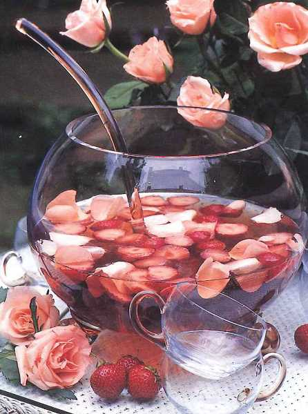 by: SUBMITTED PHOTOS: MICHELLE GARRETT  - This Rose Petal and Strawberry Punch is a stunning centerpiece for any party.