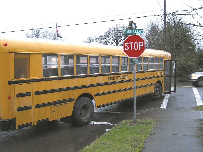 by: MOLALLA POLICE DEPARTMENT - This Molalla school bus collided with a car on Molalla Avenue and Shirley Street in February. The bus driver was cited for careless driving.
