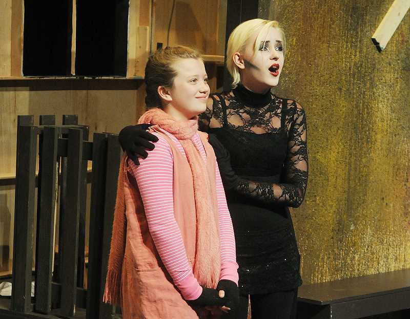 by: SETH GORDON - Words in the web -- C.S. Lewis Academy sixth grade student Lana Brady and NHS senior Annette Emmons rehearse their roles as Wilbur and Charlotte, respectively, Saturday at George Fox University's Wood-Mar theater. The play opens with 7 p.m. shows Thursday, Friday and Saturday, as well as May 22-24.