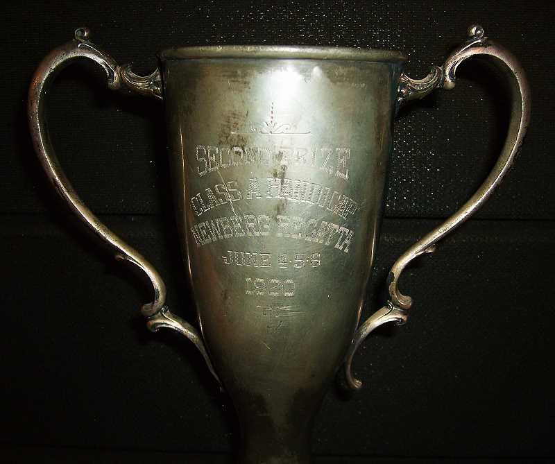 by: SUBMITTED - A piece of history - Until this year, the Newberg Boat Club had no information about the history of this  trophy from the 1920 Newberg Regatta. Club member Richard Baker recently learned that by 1920, the Newberg Regatta had become an annual event that included a parade.