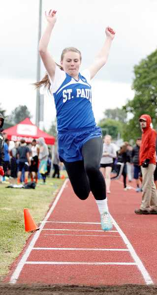 by: PHIL HAWKINS - Taking  flight - Remy Brentano launches herself in the triple jump at the Regis Twilight meet Friday. Emma Coleman paced the St. Paul girls by placing second in the shot put (34-2), while the 4x400 team placed third (4:42.12) in the meet comprised mostly of 2A and 3A schools. Cody Daffern was second in the javelin (141-7) and Joe Hiller eighth in the long jump (18-9.5) to lead the boys.