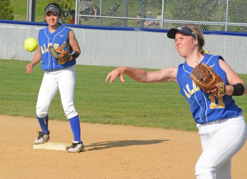 by: TIMES PHOTO: MATT SINGLEDECKER - Aloha second baseman Katie Powers fires a ball to first for an out in the fifth inning against Westview.