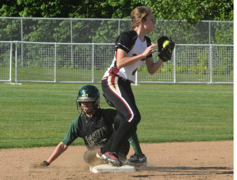 by: TIMES PHOTO: MATT SINGLEDECKER - Southridge junior shortstop Sophie Herman tags out Jesuits Alicia Taylor for a force out.