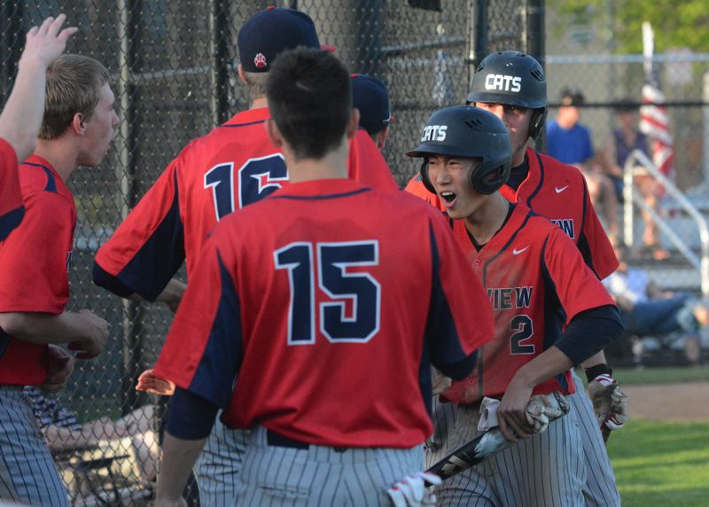 by: TIMES PHOTO: MATT SINGLEDECKER - Westview junior third baseman Taiki Ishii celebrates his go-ahead run in the ninth inning of the Wildcats 2-0 win over Sunset on Tuesday.