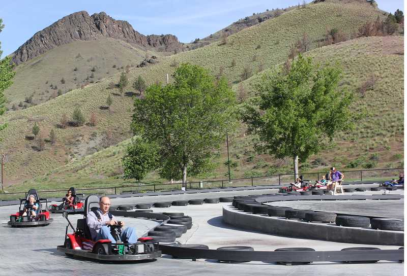 by: SUSAN MATHENY - Board Chairman Stan Sullivan and other board members got the opportunity to try out the ranch's new Canyon Car mini race track.