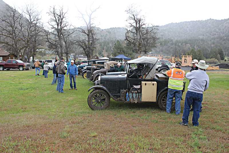 by: JEFF WILSON - The first stop on Jefferson County's four-month-long centennial celebration was at Ashwood on Saturday. Among the attendees were owners of vintage cars, above.