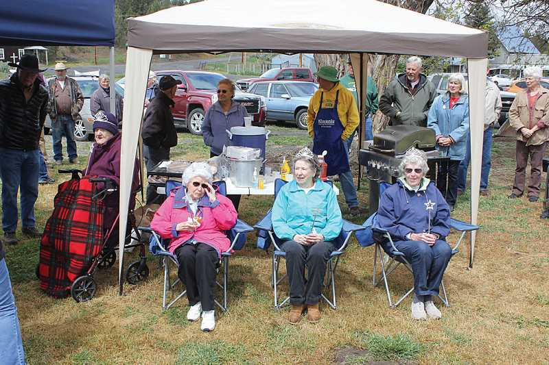by: JEFF WILSON - Longtime Ashwood residents crowned at the event included Louella Friend-DeJager, left behind tent, Sandy Symons-Keegan, Jean Guiney, and Frances Dickson.