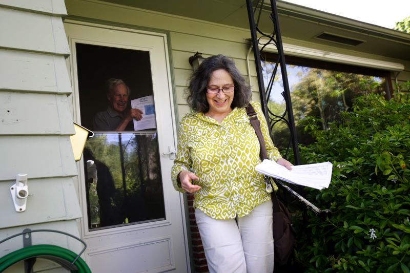 by: TRIBUNE PHOTO: JONATHAN HOUSE - Floy Jones, copetitioner for the ballot initiative to shift control of Portlands water and sewer bureaus to an independent board and district, was out canvassing voters Monday in the Gateway neighborhood.