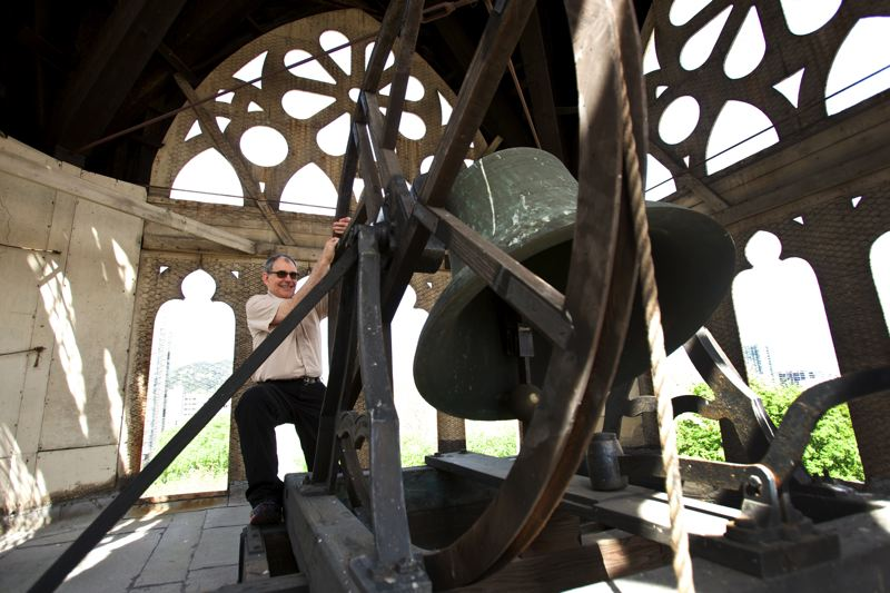 by: TRIBUNE PHOTO: JAIME VALDEZ - Doug Emmons, facility manager at First Congregational Church, puts his back into ringing the church bell. The tower around the bell needs $500,000 in repairs, and the church is asking Portlanders to contribute.