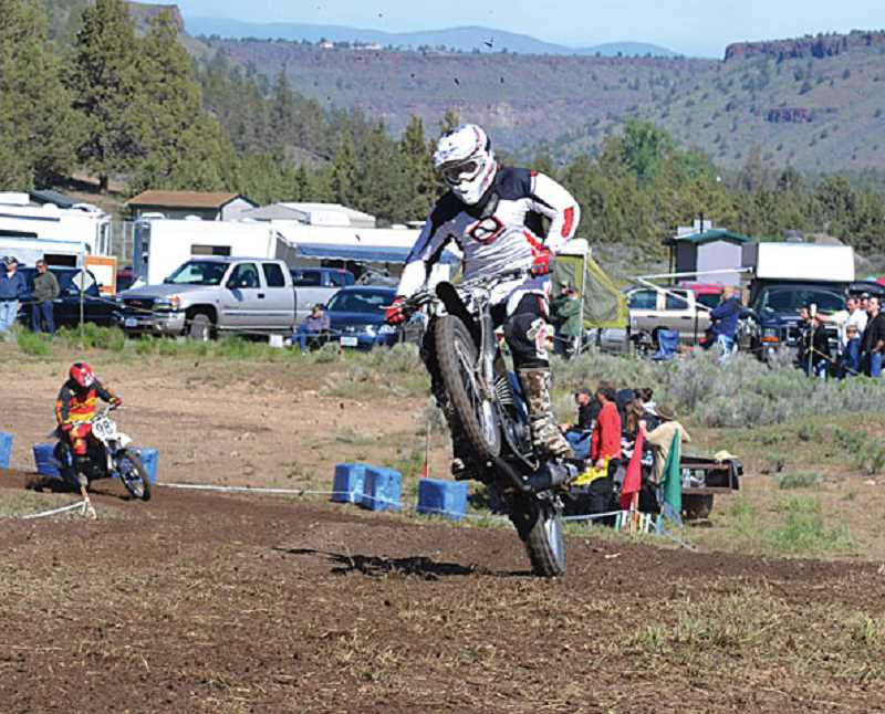 by: STEPHANIE RODERICK - A motorcyclist participates in the Steel Stampede at Crooked River Ranch.