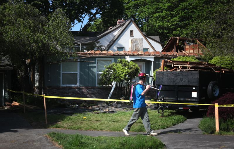 by: TRIBUNE PHOTO: JONATHAN HOUSE - A house being renovated at 3431 S.E. Rex St., has neighbors worried about possible hazardous materials contaminating the area.