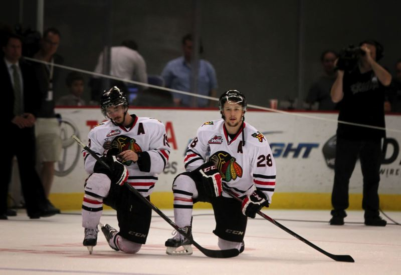 by: TRIBUNE PHOTO: JONATHAN HOUSE - Portland forwards Nic Petan (left) and Brendan Leipsic commisserate after the Winterhawks 4-2 Game 7 loss to Edmonton on Monday, a game that decided the Western Hockey League title.