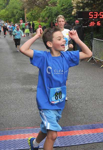 by: REVIEW PHOTO: VERN UYETAKE - Zachary Clairmont, 9, celebrates as he finishes the 5k race at Saturday's 38th annual Lake Run in Lake Oswego. Check out the story and more photos in the Neighbors section online, or flip to B1 in the print version of The Review.