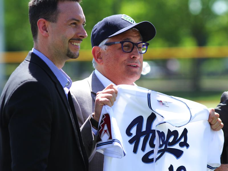 by: HILLSBORO TRIBUNE PHOTO: CHASE ALLGOOD - Hillsboro Hops general manager K.L. Wombacher (left) and Ed Tonkin, son of the late Ron Tonkin, celebrate after announcing that the stadium where the Hillsboro Hops play will now be called Ron Tonkin Field.