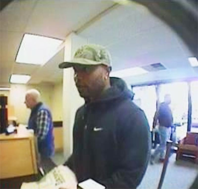 by: COURTESY PHOTO - Law enforcement officials are looking for this man, shown here on a bank security camera during Saturdays robbery.