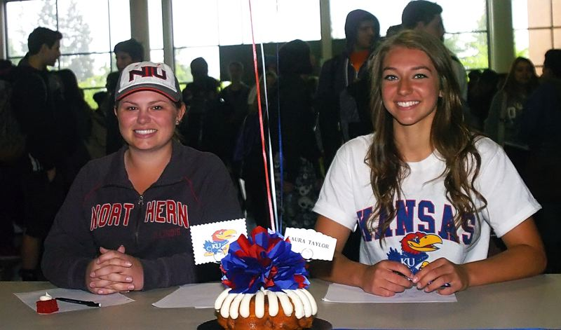 by: DAN BROOD - COLLEGE-BOUND -- Tualatin High School seniors Hayley Mortensen (left) and Laura Taylor signed the national letters of intent last week at the school.