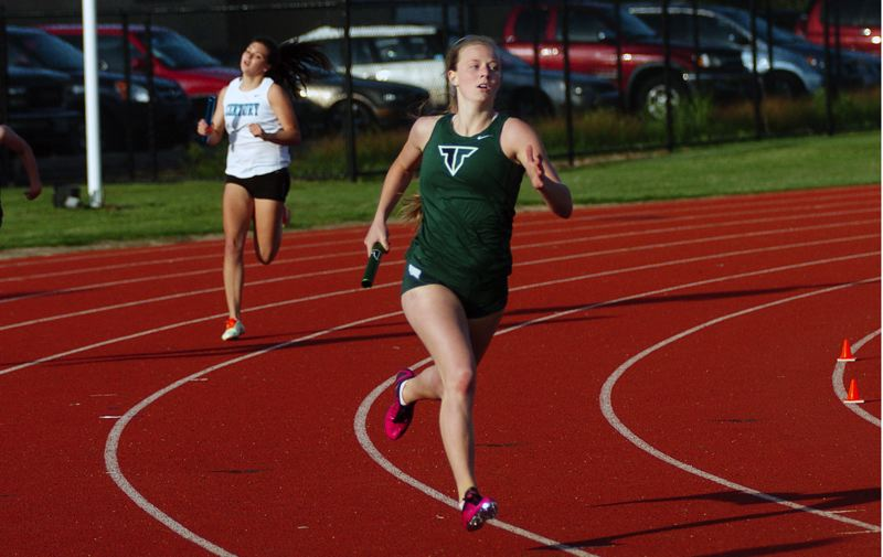by: DAN BROOD  - OUT IN FRONT -- Tigard junior Kaylie Boschma gave the Tigers 4 x 400 relay team the early lead in last week's four-school meet.