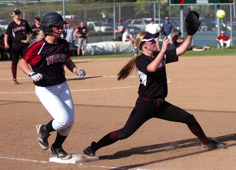 by: DAN BROOD - LOOKS SAFE -- Tualatin High School junior Alexa Kaplan (left) reaches the first-base bag before Glencoe first baseman Maria Dendinger can catch the ball on a throw from right field. Kaplan was called out on the play.