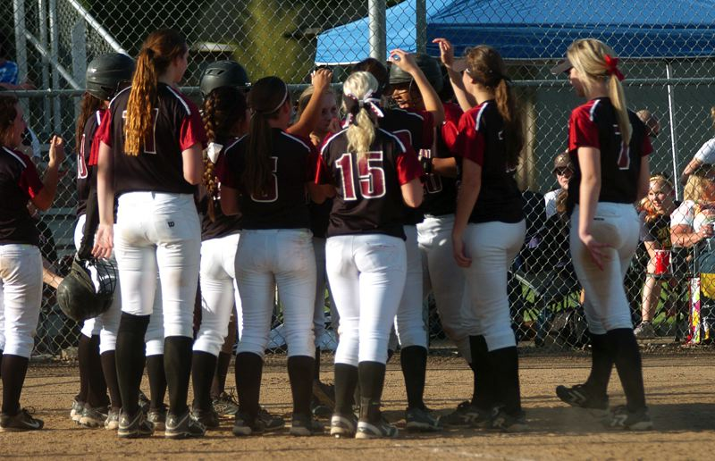 by: DAN BROOD - GATHERING AT HOME -- Members of the Tualatin High School softball team gather around junior Nikki Miller following her two-run home run at Glencoe.