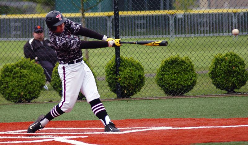 by: DAN BROOD - BAM -- Tualatin senior Jake Gellos gets his bat on the ball during Friday's game at Tigard.