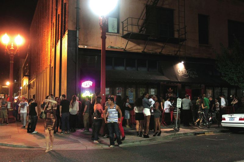 by: TRIBUNE FILE PHOTO: JONATHAN HOUSE - Crowds gather around the former Crown Room after midnight two years ago when the Old Town nightclub was operating. A new plan would put a vegan strip club in the building.