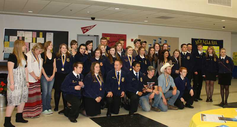 by: PEGGY SAVAGE - The entire membership of Molalla High School FFA pose for a group photo at the end of the evening awards ceremony.