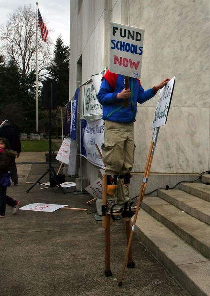 by: TRIBUNE FILE PHOTO - Oregon's Supreme Court ruled Thursday, May 15, that the Legislature could block anti-war protesters from overnight camping on the Capitol steps. The steps in front of the Capitol have been the site of many protests, including by students demanding more school funding.